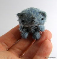 tiny_bluebearhand